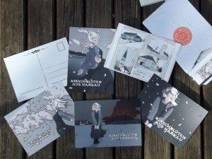 Ein Stapel Postkarten von der Druckerei MOO