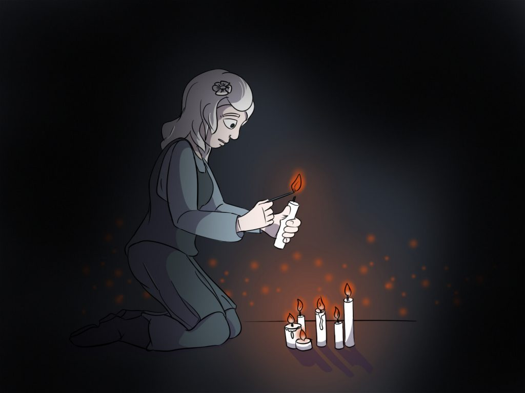Luise aus Harkau zündet symbolisch eine Kerze in Gedenken an die Novemberpogrome 1938 an